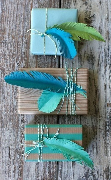 Gift decoration with paper feathers