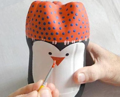 Drawing eyes, beak and cap Penguin