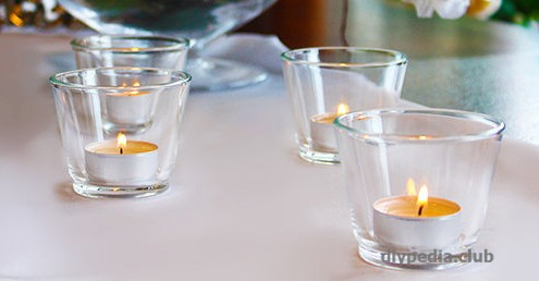 Candle tablet in a glass candlestick